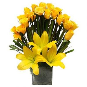 The FloralMart® Mother's Day Special Premium Fresh Flowers Glass Vase of 20 Yellow Roses & 03 Lilies